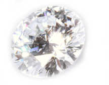 Brilliant White round cut diamond from human hair, frontal view