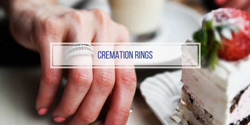 women's hand wearing a cremation ring